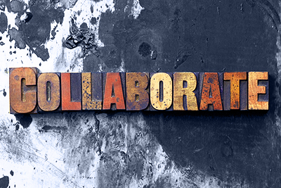 The word Collaborate written in antique letterpress printing blocks.