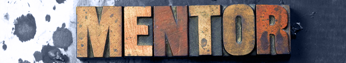 The word Mentor written in antique letterpress printing blocks.